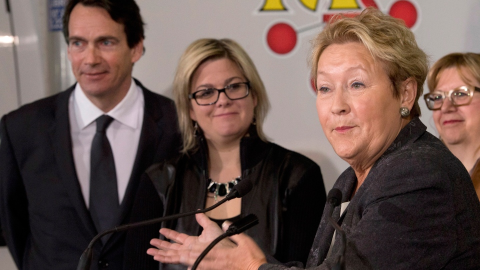 Parti Quebecois Leader Pauline Marois, right, responds to reporters questions at a news conference in Levis, Que., Thursday, March 13, 2014. (Jacques Boissinot / THE CANADIAN PRESS)