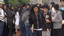 Hundreds of mourners gathered in Surrey, B.C. Friday night to remember slain 19-year-old Maple Batalia. Sept. 30, 2011. (CTV)
