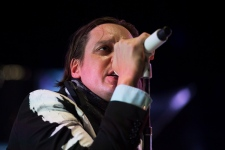 Win Butler performs with his band Arcade Fire