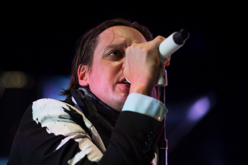 Lead vocalist Win Butler performs with his band Arcade Fire at the Air Canada Centre in Toronto on Thursday, March 13, 2014. (THE CANADIAN PRESS/Michelle Siu)