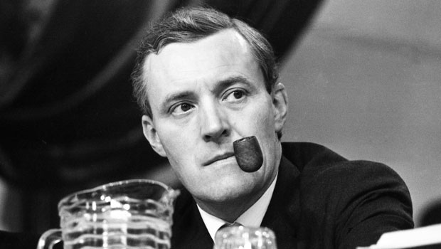 Tony Benn puffs on his pipe