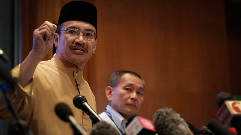 Malaysia's Minister of Transport Hishamuddin Hussein, left and Malaysia Airlines Group CEO Ahmad Jauhari Yahya, right, answers queries from the media during a press conference regarding missing Malaysia Airlines jetliner MH370 in Sepang, Malaysia, Friday, March 14, 2014. (AP / Wong Maye-E)