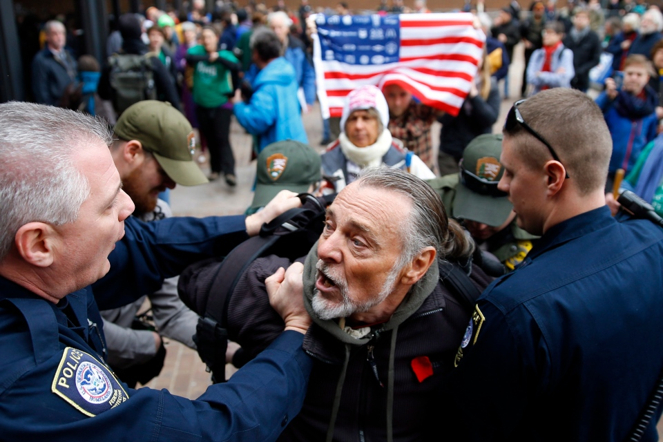 Police detain a protester demonstrating in opposition to the proposed Keystone XL oil pipeline outside the Federal Building in Philadelphia, Monday, March 10, 2014. (AP / Matt Rourke)