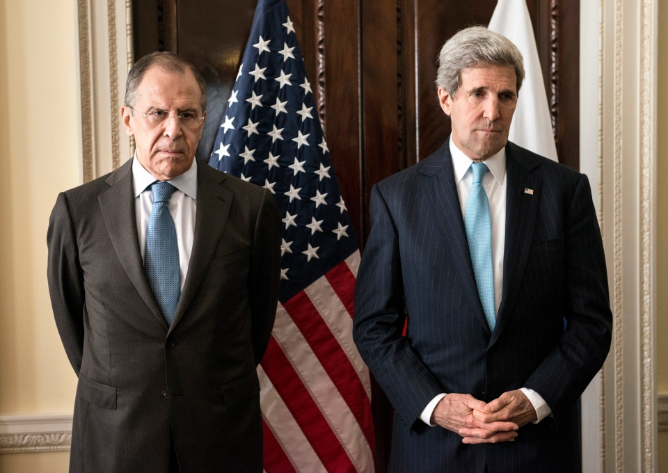 Russian Foreign Minister Sergey Lavrov, left, and U.S. Secretary of State John Kerry stand together before a meeting at Winfield House in London, Friday March 14, 2014. (AP / Brendan Smialowski)