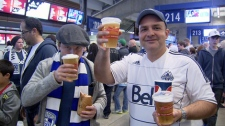 Satisfied fans enjoy a cool beverage at the second sporting event held at the newly-renovated BC Place stadium. Oct. 2, 2011. (CTV)