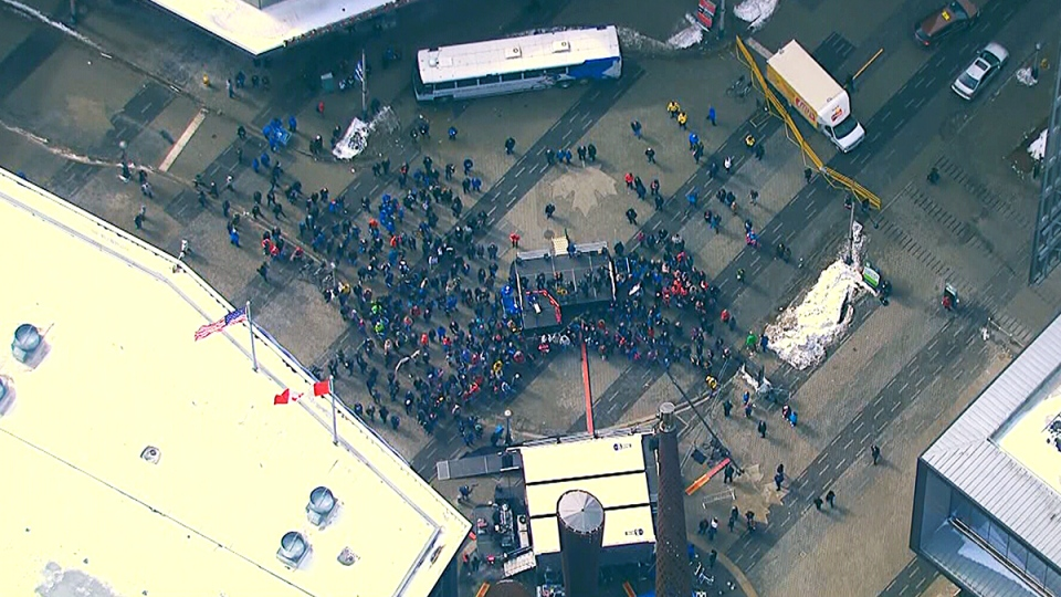 """A crowd gather's for the launch of Clara Hughes' """"Big Ride"""" for mental health awareness, in Toronto, Friday, March 14, 2014."""