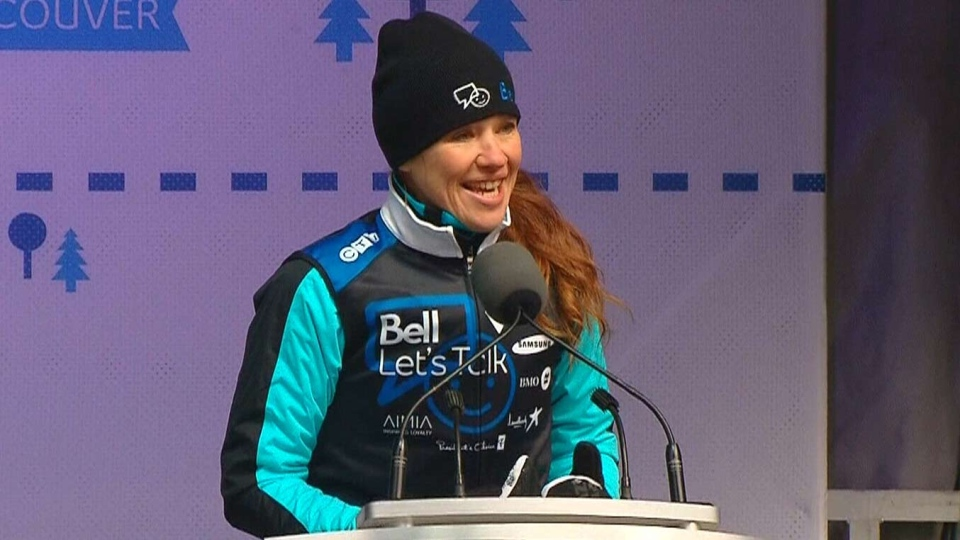 Olympian Clara Hughes speaks during her 'Big Ride' kick off in Toronto, Friday, March 14, 2014.