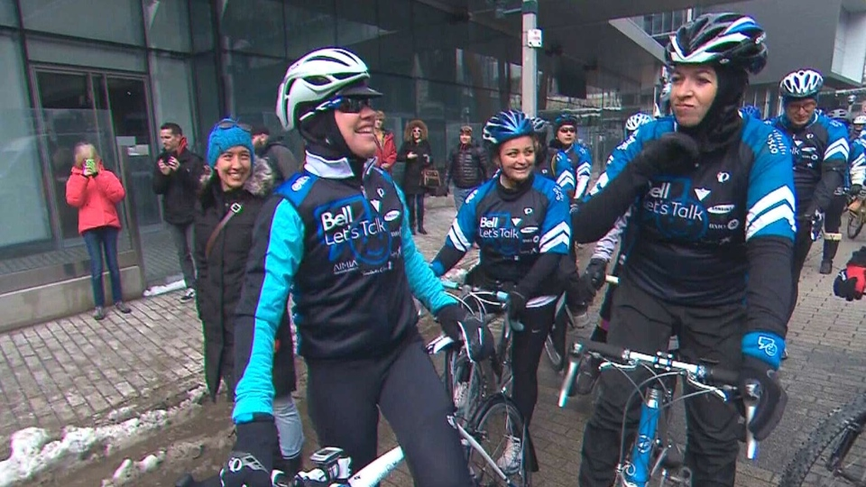 Olympian Clara Hughes gets ready to kick off her 110-day bike trek around Canada, Friday, March 14, 2014.