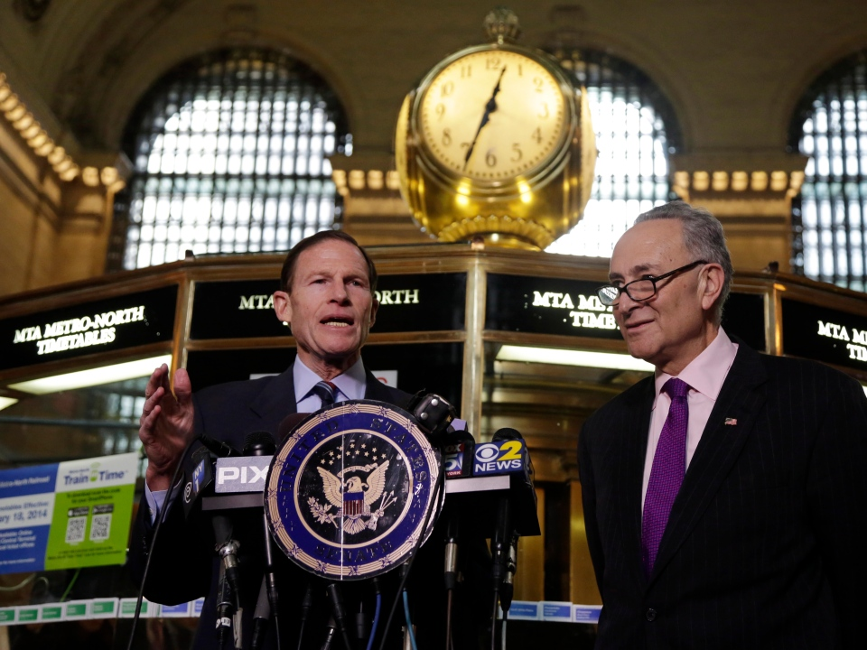 U.S. Sen. Richard Blumenthal, D-CT, left, and U.S. Sen. Charles Schumer, D-NY, comment during a news conference on a report by the Federal Railroad Administration about the Metro-North Railroad, at the information booth in New York's Grand Central Terminal, Friday, March 14, 2014. (AP / Richard Drew)