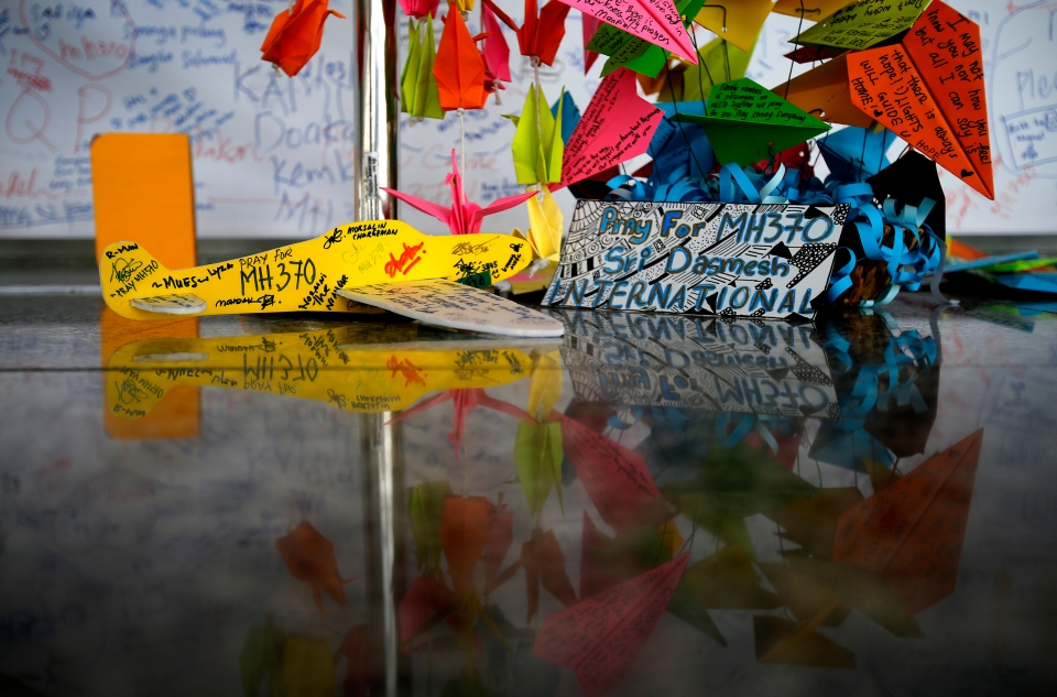 A foam plane with messages and other cards with personalized messages dedicated to people involved with the missing Malaysia Airlines jetliner MH370, is placed at the viewing gallery at Kuala Lumpur International Airport in Sepang, Malaysia on Saturday, March 15, 2014. (AP / Wong Maye-E)
