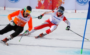 Mac Marcoux of Canada, right, and his guide Robin Femy race to win 3rd place in the men's downhill, visually impaired event at the 2014 Winter Paralympic, Saturday, March 8, 2014, in Krasnaya Polyana, Russia. (AP / Dmitry Lovetsky)