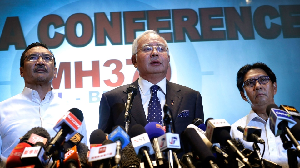 Malaysian Prime Minister Najib Razak, center, Malaysia's Minister for Transport Hishamuddin Hussein, left, and director general of the Malaysian Department of Civil Aviation, Azharuddin Abdul Rahman, delivers a statement to the media regarding the missing Malaysia Airlines jetliner MH370 in Sepang, Malaysia on Saturday, March 15, 2014. (AP / Wong Maye-E)