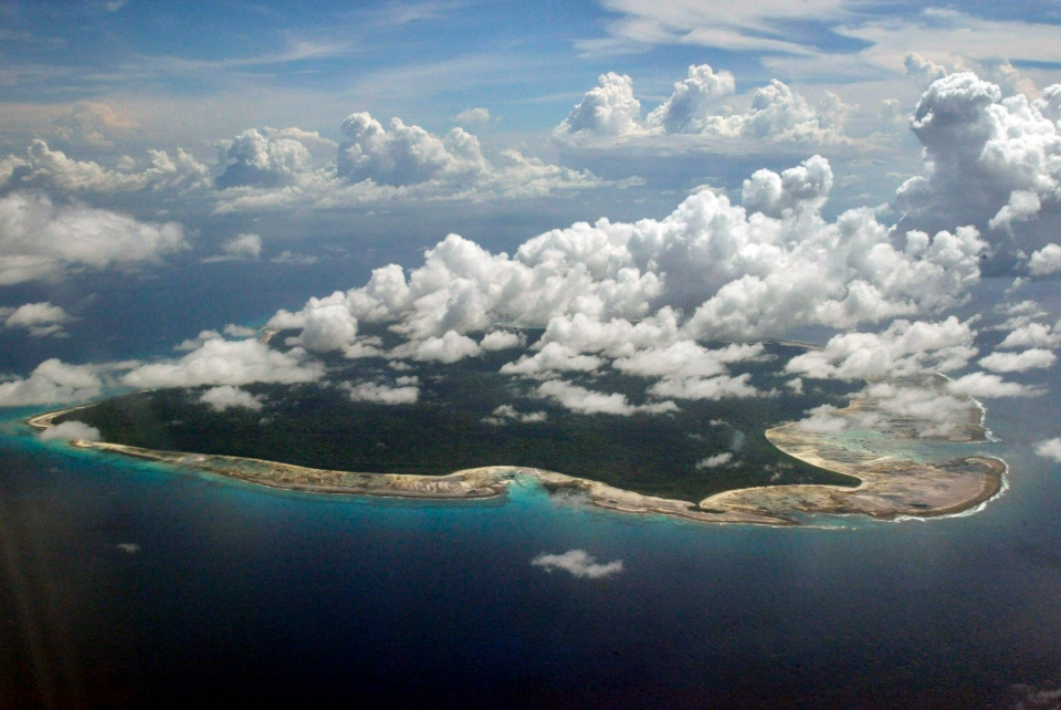 In this Nov. 14, 2005 file photo, clouds hang over the North Sentinel Island, in India's southeastern Andaman and Nicobar Islands. (AP / Gautam Singh)