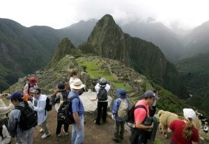 In this March 26, 2008 file photo, tourists look at the Inca citadel of Macchu Picchu in Peru. (AP / Martin Mejia)