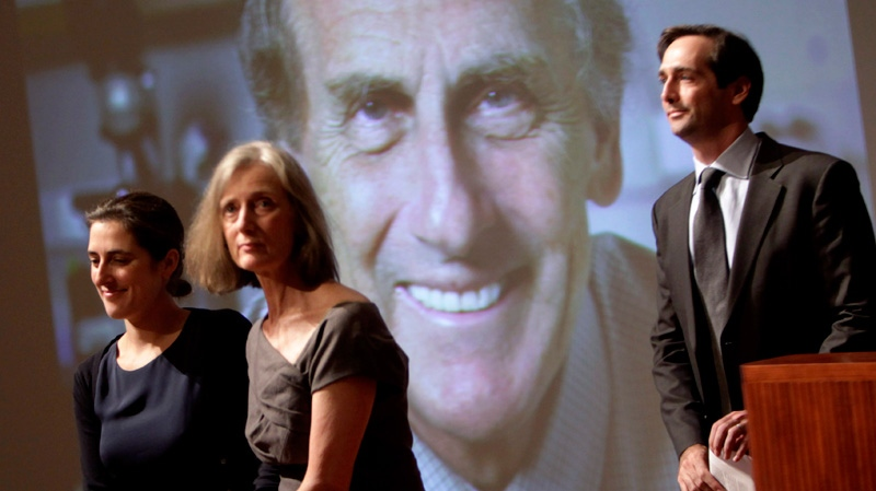 Family members of Nobel prize winner Ralph Steinman walk in front of a picture of Steinman during a ceremony honoring him at Rockefeller University in New York, Monday, Oct. 3, 2011. (AP / Seth Wenig)