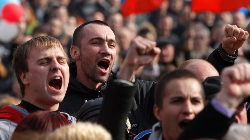 People shout slogans during a pro Russian rally at a central square in Donetsk, eastern Ukraine, Saturday, March 15, 2014. (AP / Sergei Grits)