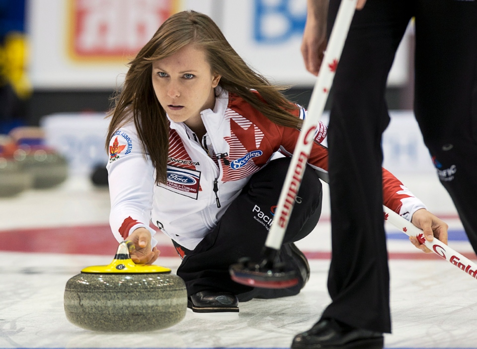 Canada's Rachel Homan delivers a rock as they play Russia at the Ford World Women's Curling Championships in Saint John, N.B. on Saturday, March 15, 2014. THE CANADIAN PRESS/Andrew Vaughan