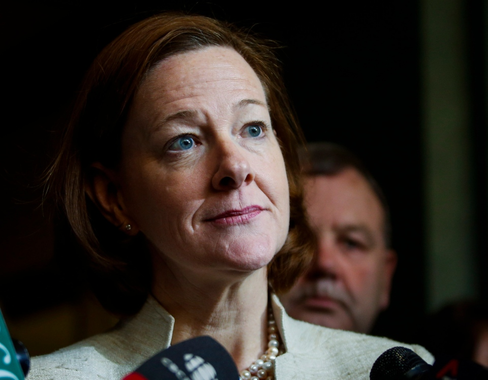 Alberta Premier Alison Redford scrums with the media following a meeting of the provincial PC Party executive in Calgary, Alta., on March 15, 2014. (Jeff McIntosh/THE CANADIAN PRESS)