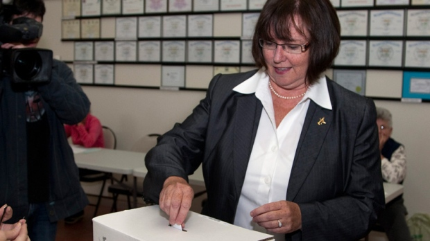 Prince Edward Island Progressive Conservative leader Olive Crane casts her ballot in the provincial election in St. Andrews, P.E.I., on Monday, Oct. 3, 2011. (Andrew Vaughan / THE CANADIAN PRESS)