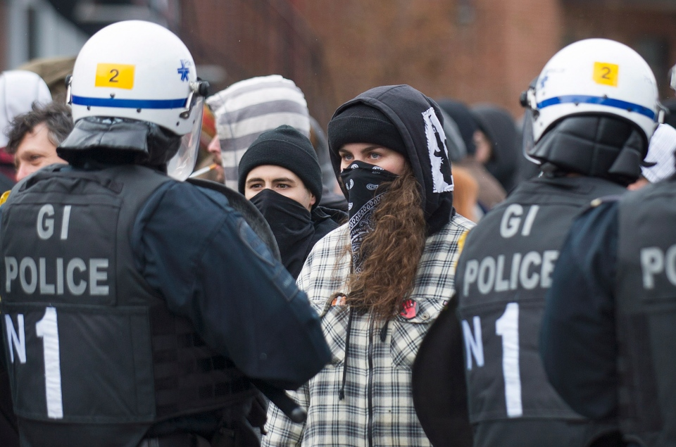 Protesters clash with police during an anti police brutality demonstration in Montreal on March 15, 2014. (Graham Hughes / THE CANADIAN PRESS)