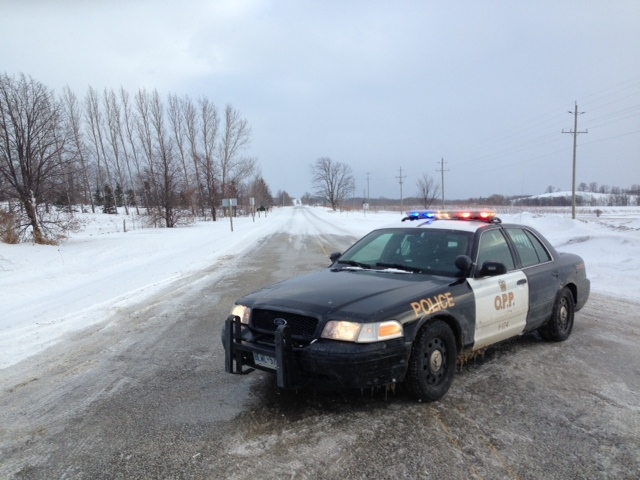 An OPP cruiser blocks off Grey County Road 2 where a Good Samaritan was struck and killed after trying to help another motorist. (Don Wright / CTV Barrie)