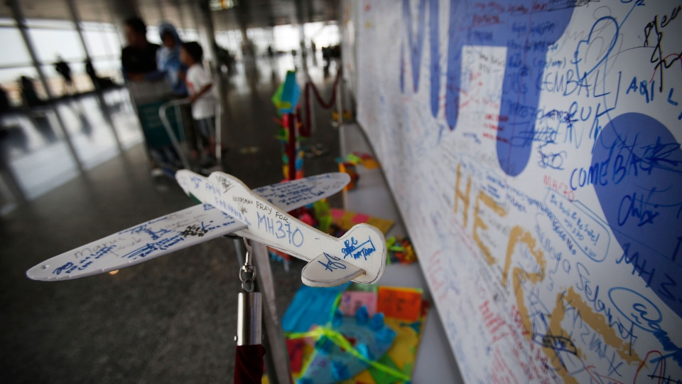 A foam plane with messages and cards with personalized messages dedicated to people involved with the missing Malaysia Airlines jetliner MH370, are placed in the viewing gallery at Kuala Lumpur International Airport, Saturday, March 15, 2014 in Sepang, Malaysia. (AP / Wong Maye-E)