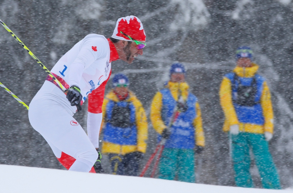 Brian Mckeever of Canada races during the semifinal of the men's cross country 1km sprint, visually impaired event at the 2014 Winter Paralympic, Wednesday, March 12, 2014, in Krasnaya Polyana, Russia. (AP / Dmitry Lovetsky)