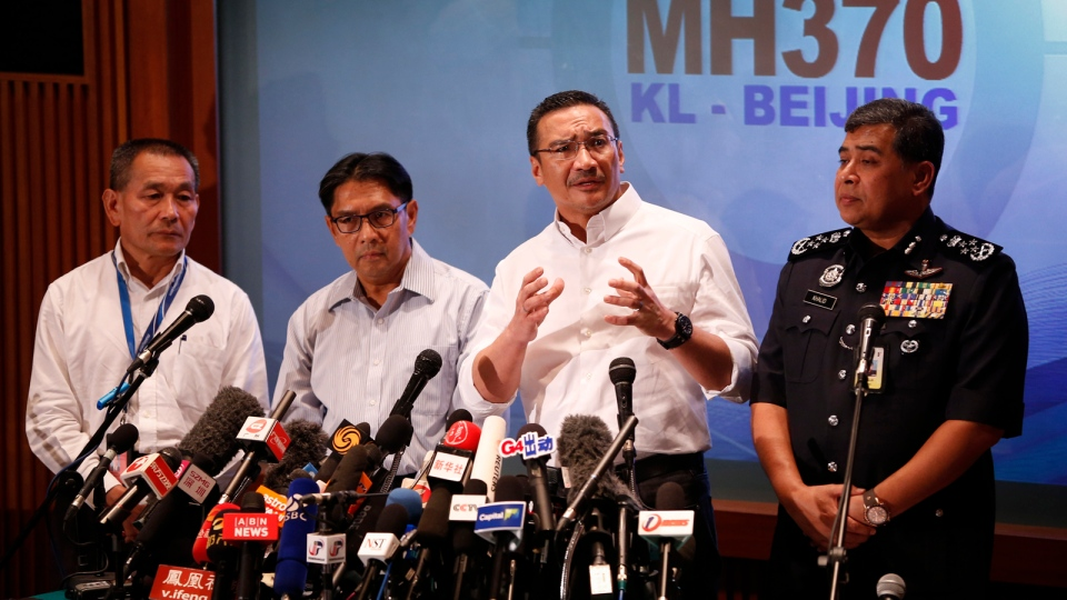 Malaysia's acting minister of transport Hishamuddin Hussein, second from right, speaks during a press conference as director general of the Malaysian Department of Civil Aviation, Azharuddin Abdul Rahman, second from left, and Malaysia Airlines Group CEO Ahmad Jauhari Yahya, left, and Malaysia Inspector-General of Police Khalid Abu Bakar, right, looks on at a hotel in Kuala Lumpur, Malaysia, Sunday, March 16, 2014. (AP / Vincent Thian)