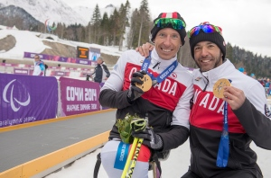 Chris Klebl, with his Men's 10km Sitting gold medal, and Brian McKeever, with his 15km free Visually Imaired gold medal, celebrate at the 2014 Paralympic Winter Games in Sochi, Russia on March 16, 2014. (Provided/Canadian Paralympic Committee/Matthew Murnaghan)