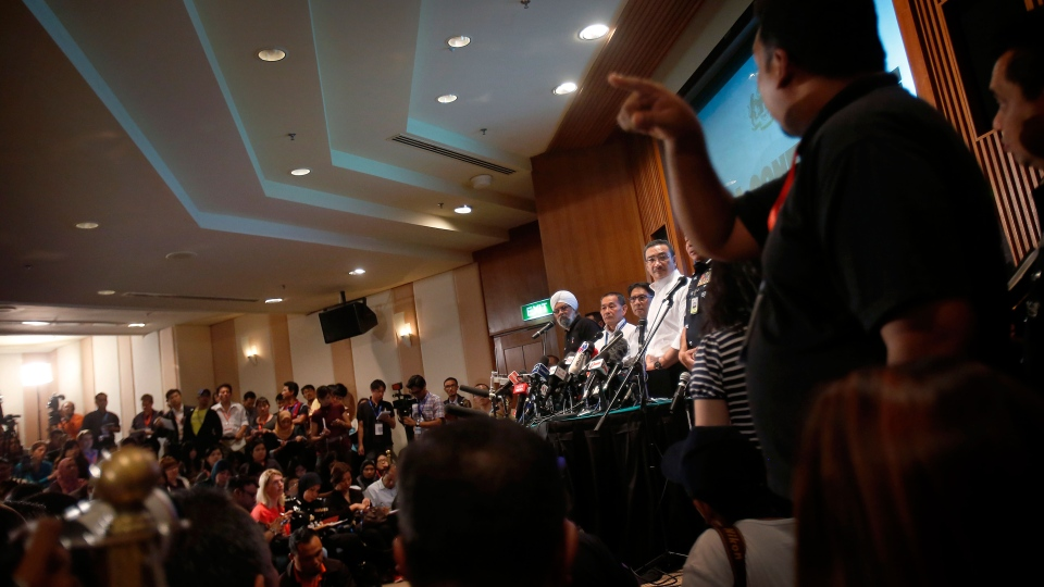 Malaysia's acting minister for transport Hishamuddin Hussein, center, takes queries from the media during a press conference regarding missing Malaysia Airlines flight MH370, Sunday, March 16, 2014 in Sepang, Malaysia. (AP / Wong Maye-E)