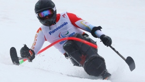 Josh Dueck of Canada races during men's super combined, slalom, sitting event at the 2014 Winter Paralympic in Krasnaya Polyana, Russia, Tuesday, March 11, 2014. (AP / Dmitry Lovetsky)