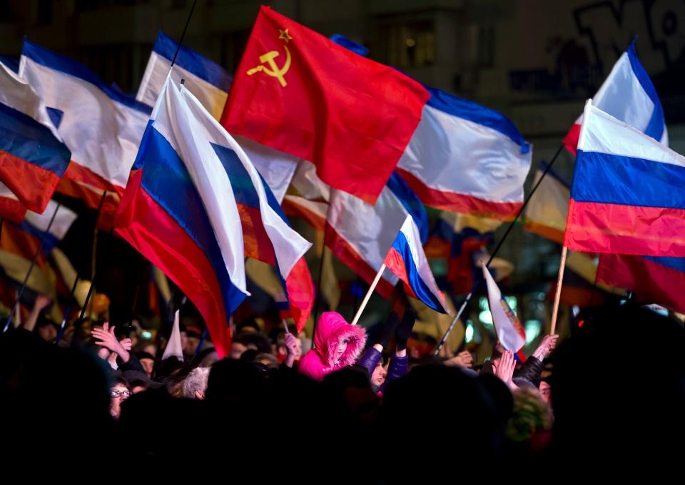 Pro-Russian people celebrate in Lenin Square, in Simferopol, Ukraine on March 16, 2014. (AP / Vadim Ghirda)