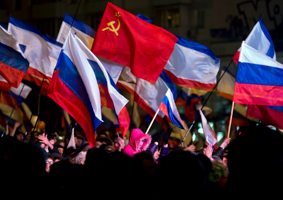 Pro-Russian people celebrate the annexation of Crimea in Lenin Square, in Simferopol, Ukraine on March 16, 2014. (AP / Vadim Ghirda)