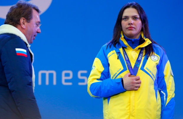 Ukraine athlete covers her medal