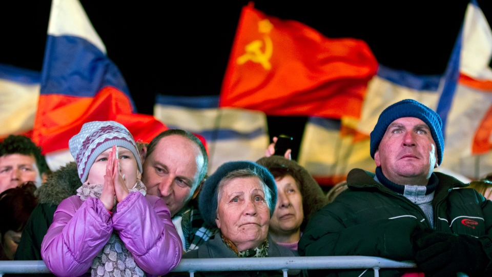 Pro-Russian people celebrate in Lenin Square, in Simferopol, Ukraine, Sunday, March 16, 2014. (AP / Vadim Ghirda)