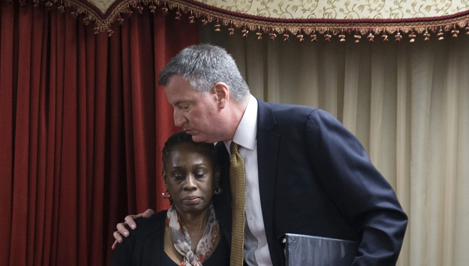 New York City Mayor Bill de Blasio, right, hugs his wife Chirlane McCray after speaking at the Church of God of Third Avenue as the congregation welcomed members of the Spanish Christian Church after the church was destroyed by Wednesday's explosion in the East Harlem neighborhood of New York, Sunday, March 16, 2014. (AP / John Minchillo)