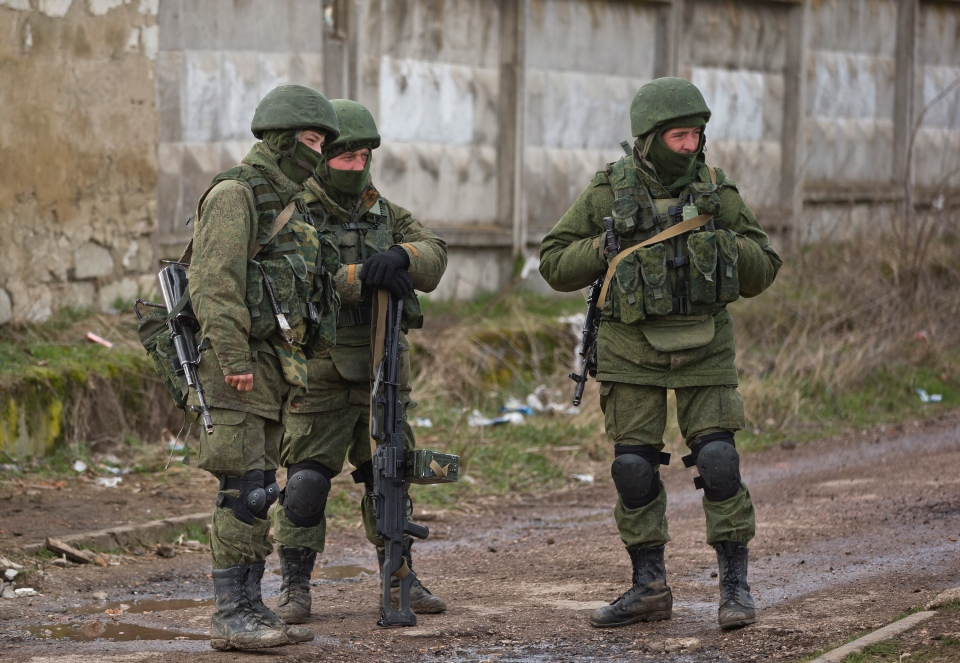 Pro-Russian soldiers stand outside an Ukrainian military base in Perevalne, Ukraine, Monday, March 17, 2014. (AP / Vadim Ghirda)