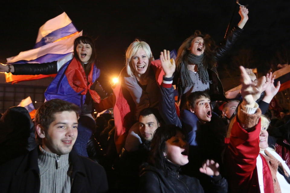 Pro-Russian people celebrate in Lenin Square, in Simferopol, Ukraine, Sunday, March 16, 2014. (AP / Max Vetrov)