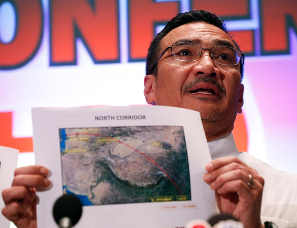 Malaysia's acting Transport Minister Hishamuddin Hussein shows maps of northern search corridor during a press conference at a hotel near the Kuala Lumpur International Airport, in Sepang, Malaysia, Monday, March 17, 2014. (AP / Vincent Thian)