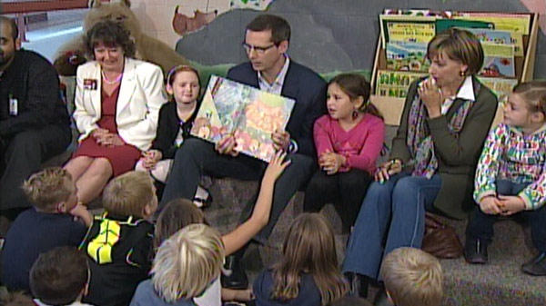 Liberal Leader Dalton McGuinty reads to students during a campaign stop in Cambridge, Ont. on Tuesday, Oct. 4, 2011.