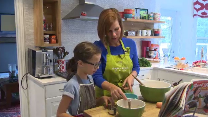 Nutrition consultant Wendy McCallum works in the kitchen with her daughter, Georgia.