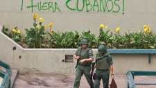 Bolivarian National Guard officers patrol Caracas