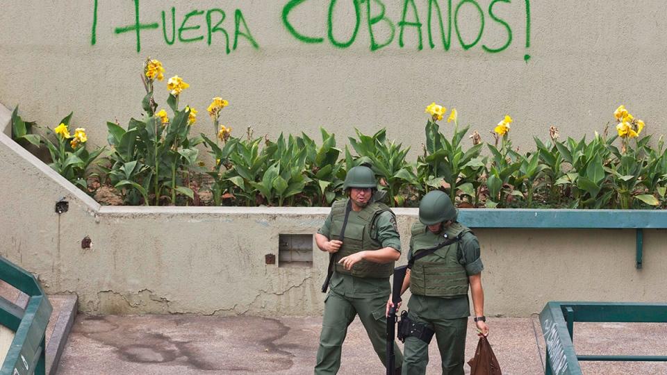 Bolivarian National Guard officers patrol Plaza Altamira after taking control of it, in Caracas, Venezuela, Monday, March 17, 2014. (AP / Esteban Felix)