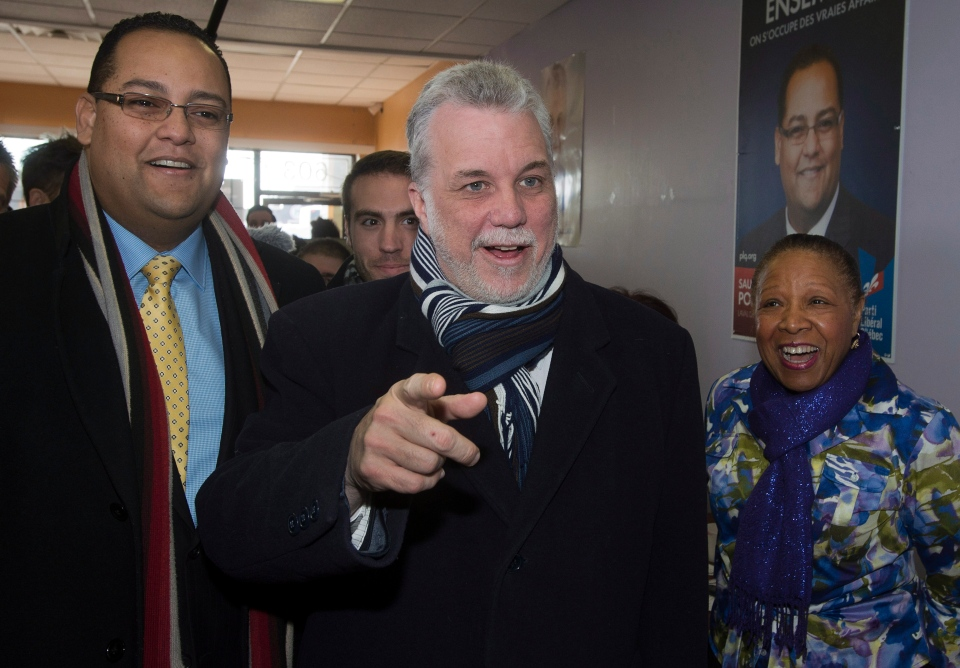Quebec Liberal leader leader Philippe Couillard speaks to campaign workers while visiting the local riding office for Laval-des-Rapides riding Monday, March 17, 2014 in Laval, Que. (Ryan Remiorz / THE CANADIAN PRESS)