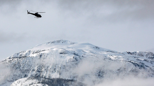 A search and rescue helicopter heads toward a dead