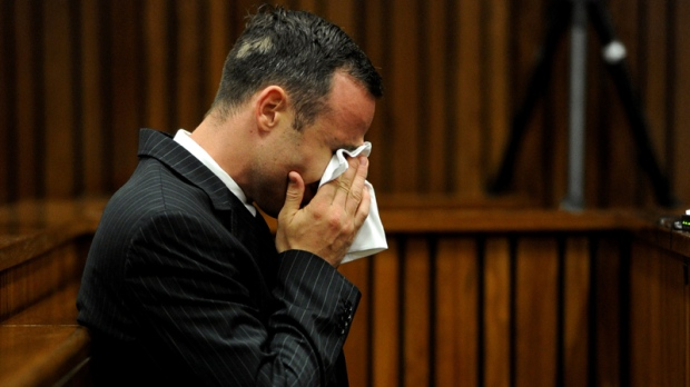 Oscar Pistorius sits in the dock in Pretoria court