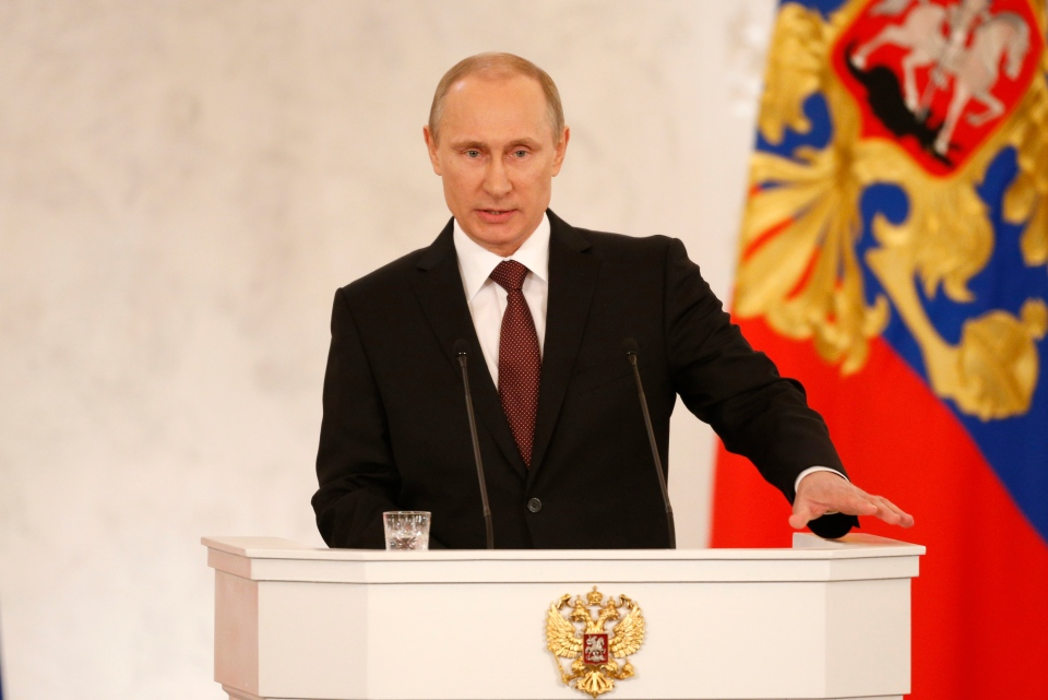 Russian President Vladimir Putin addresses the Federation Council in Moscow's Kremlin on Tuesday, March 18, 2014. (AP / Alexander Zemlianichenko)