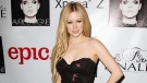Avril Lavigne is seen at her album release party in New York in this Nov. 5, 2013. (StarPix / Kristina Bumphrey)