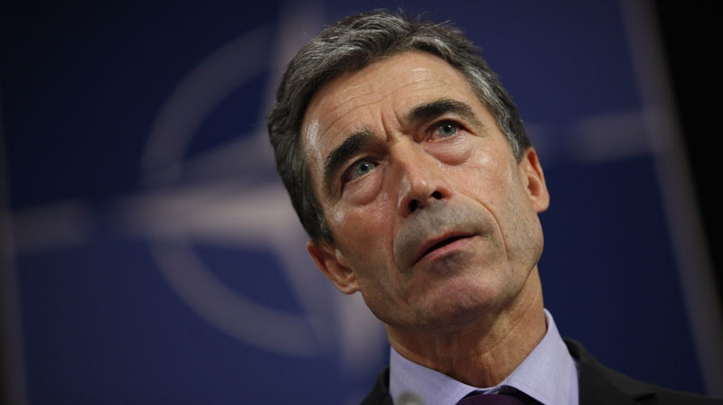 NATO Secretary General Anders Fogh Rasmussen listens to questions during a press conference on Oct. 3, 2011