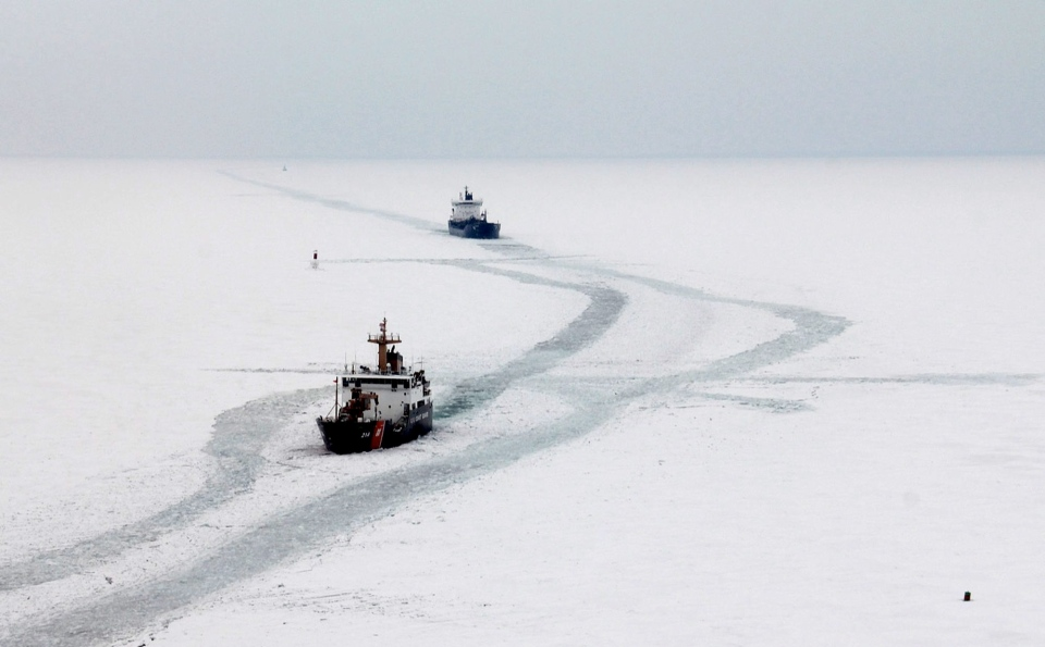 In a Feb. 19, 2014 photo provided by the U.S. Coast Guard, the Cutter Hollyhock cuts a track line for the motor vessel Algosea in Lake St. Clair, Mich. (AP / U.S. Coast Guard, Petty Officer 1st Class Randy Beauchamp)